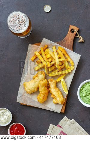 Fish And Chips On A Dark Background. British Fast Food. Recipes. Snack To Beer. English Cuisine.