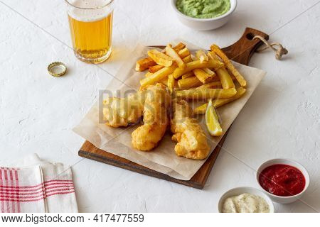 Fish And Chips On A White Background. British Fast Food. Recipes. Snack To Beer. English Cuisine.