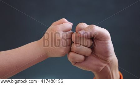 Teamwork Business Concept. Fist To Fist Commit Solidarity A Respect And Brotherhood Gesture. Busines