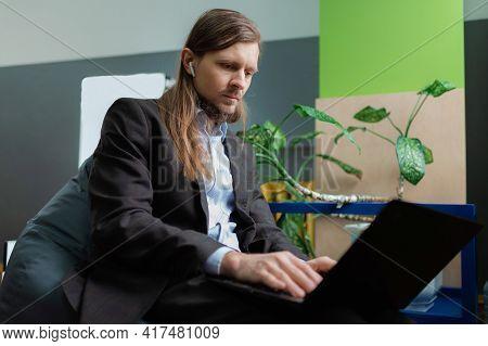 A Man Attending An Online Meeting In Office