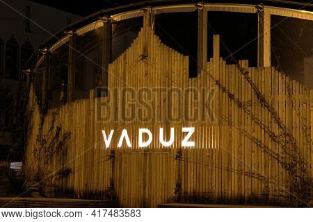 Wall Of A Wooden Building Illuminated With A Sign In Vaduz In Liechtenstein 31.3.2021