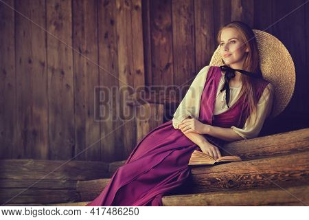 Victorian Woman Portrait. Dreaming Country Side Romantic Beauty Girl Over Dark Wooden Background Cop