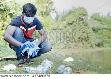 Frontline Healthcare Worker Or Waste Collector Busy Collecting Discarded Medical Or Ppe Waste From N