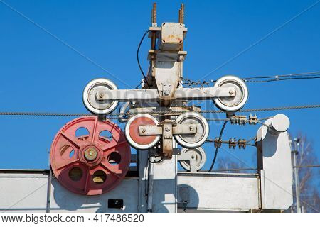 Rollers And Wheels For Fixing The Steel Cable Of A Rope Hoist In A Ski Resort. The Drive Mechanism A