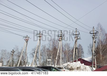 Electricity Concept, Concrete Pillars With High Voltage Wires. Against The Background Of The Blue Sk