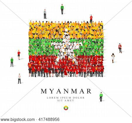 A Large Group Of People Are Standing In Green, Yellow, White And Red Robes, Symbolizing The Flag Of