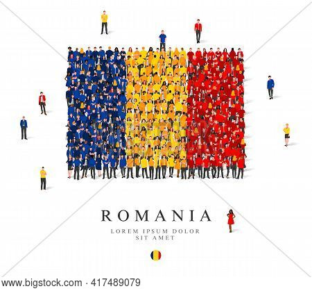 A Large Group Of People Are Standing In Blue, Yellow And Red Robes, Symbolizing The Flag Of Romania.
