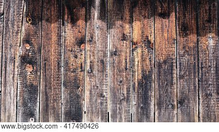 Country Style Background Of Street Wood Surface Of Dried Knotty Gray Planks Illuminated By The Sun D
