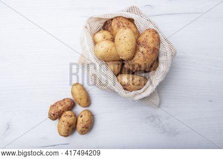 Raw Fresh Organic Potatoes. Full Bag Of Potatoes. Burlap Sack With Potatoes. Space For Text