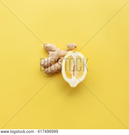 Half Of Lemon And Ginger On Yellow Background. Healthy Eating, Antivirus Concept