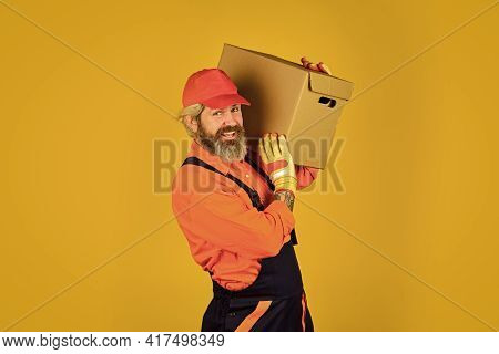 Postman Delivery Worker. Handsome Man Red Cap Yellow Background. Delivering Purchase. Shopping. Bach
