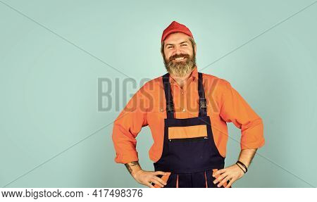 Engineer And Industrial Building. Repair Advertisement. Builder Or Plasterer. Mature Repairman In Un