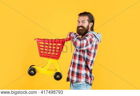 Householding. Shopaholic In Shop Or Store. Buy And Purchase. Mature Guy In Checkered Shirt Go Shoppi