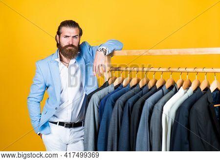 Elegant Businessman Choose Elegant Apparel For Formal Event. Atelier Or Wardrobe. Gentleman With Gro
