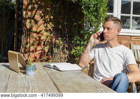 Man Working From Home Remote Working Online In The Garden