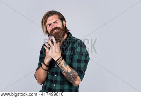 Modern Looking Bearded Hipster With Mic. Music Concept. Brutal Handsome Man With Moustache Singing.