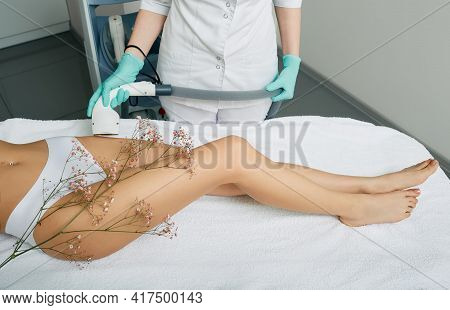 Bikini Zone Laser Hair Removal For A Woman Using A Medical Laser. Woman Receiving Laser Epilation On