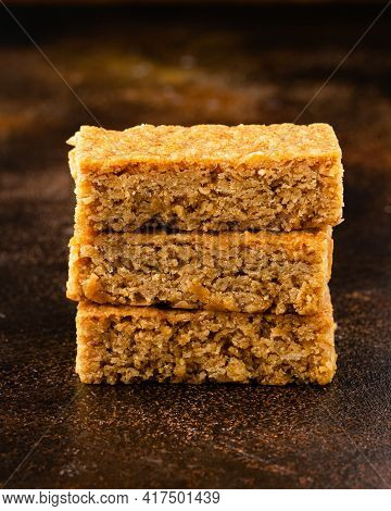 Stack Of Three Pieces Of Golden Syrup Flapjack As Background, Healthy Sweet Snack.
