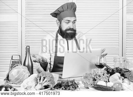 Hipster In Hat And Apron Learning How To Cook Online. Culinary Education Online. Elearning Concept.