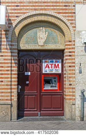 Amsterdam, Netherlands - May 14, 2018: Atm Built In Arch Door In Amsterdam, Holland.