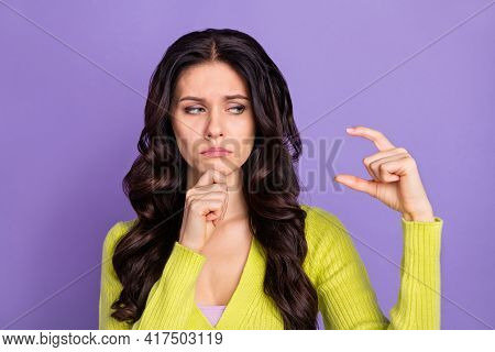 Photo Portrait Of Sad Unhappy Brunette Showing Fingers Little Amount Size Isolated On Pastel Violet