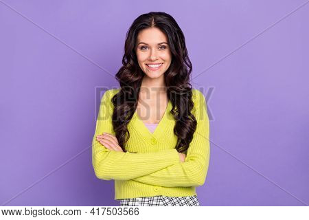 Photo Of Cute Confident Lady Crossed Hands Beaming Smile Wear Green Cardigan Isolated Purple Color B