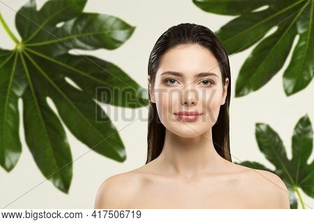 Woman Beauty Face Natural Make Up. Green Leaf Cosmetic Skin Care. Wet Hair Perfect Model In Tropical