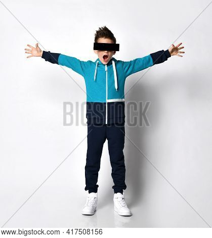 Excited Young Guy In A Comfortable Tracksuit Hoodie, Wearing Augmented Reality Glasses, Dark Glasses