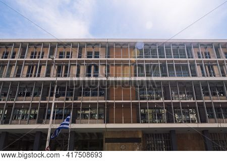 Thessaloniki, Greece Courthouse Facade With Hellenic Flag Waving. Exterior Day Low Angle View Of Cou