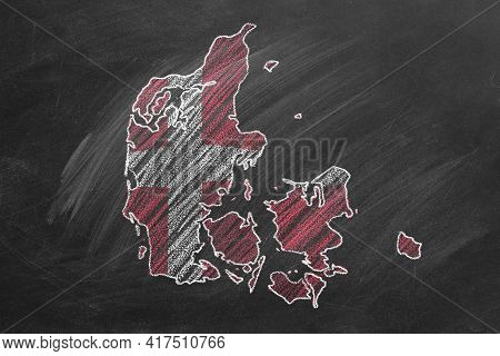 Country Map And Flag Of Denmark Drawing With Chalk On A Blackboard. One Of A Large Series Of Maps An