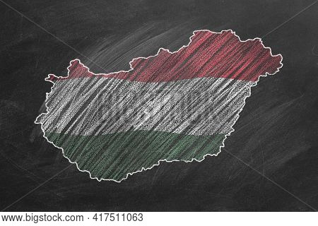Country Map And Flag Of Hungary Drawing With Chalk On A Blackboard. One Of A Large Series Of Maps An