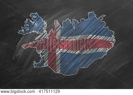 Country Map And Flag Of Iceland Drawing With Chalk On A Blackboard. One Of A Large Series Of Maps An