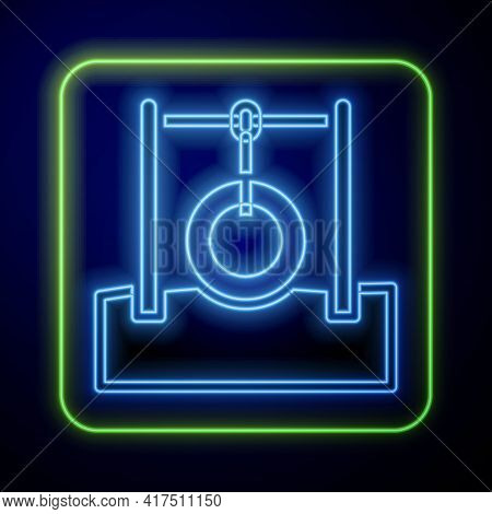 Glowing Neon Car Tire Hanging On Rope Icon Isolated On Blue Background. Playground Equipment With Ha