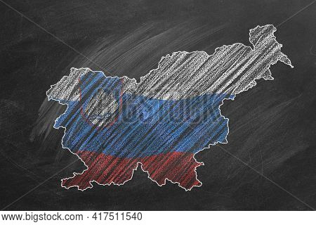 Country Map And Flag Of Slovenia Drawing With Chalk On A Blackboard. One Of A Large Series Of Maps A