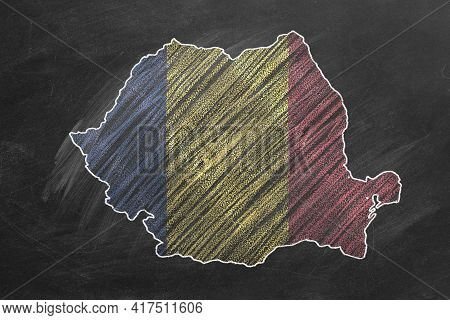 Country Map And Flag Of Romania Drawing With Chalk On A Blackboard. One Of A Large Series Of Maps An