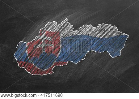 Country Map And Flag Of Slovakia Drawing With Chalk On A Blackboard. One Of A Large Series Of Maps A