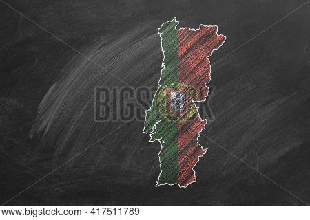 Country Map And Flag Of Portugal Drawing With Chalk On A Blackboard. One Of A Large Series Of Maps A