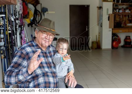 Happy Senior Caucasian Old Male Person Portrait Sitting At Home Garage Workhouse With Cite Little Ch