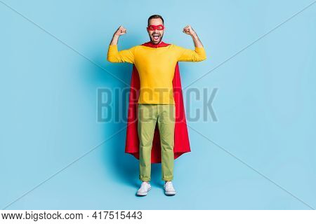 Full Length Body Size Photo Of Hero Wearing Mantle Mask Showing Strong Biceps Isolated On Vivid Blue