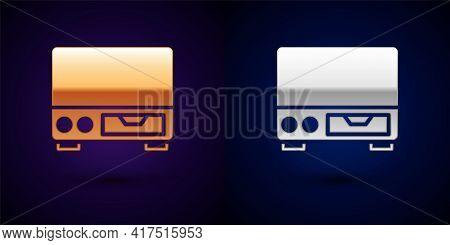 Gold And Silver Old Video Cassette Player Icon Isolated On Black Background. Old Beautiful Retro Hip