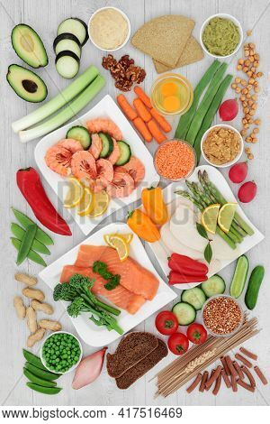 Low glycemic diabetic health food all below 55 on the GI index and high in antioxidants, omega 3, protein, anthocyanins, smart carbs, vitamins and minerals. Health care concept. On rustic wood.