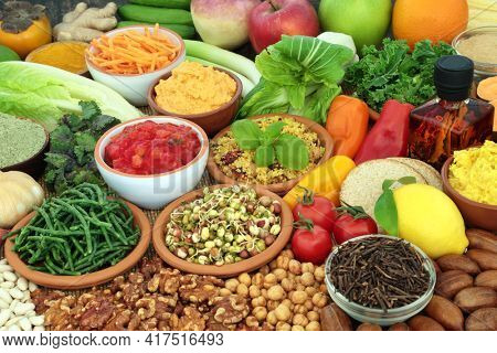 Health food for a balanced vegan diet high in protein, omega 3, vitamins, minerals, antioxidants, anthocyanins and fibre. Vegetables, fruit, olive oil, herbs, dips, grains, black tea and nuts.