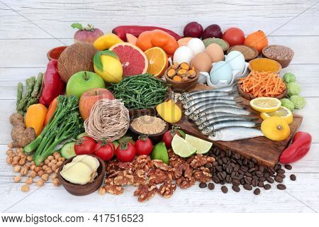 Worlds healthiest food selection  high in protein, omega 3, vitamins, minerals, antioxidants, anthocyanins and fibre. Large collection of immune boosting health foods concept on rustic wood. Top view.
