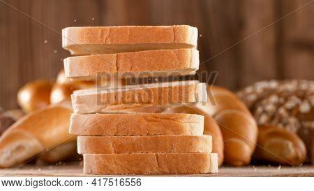 Falling sliced freshly baked toast bread.