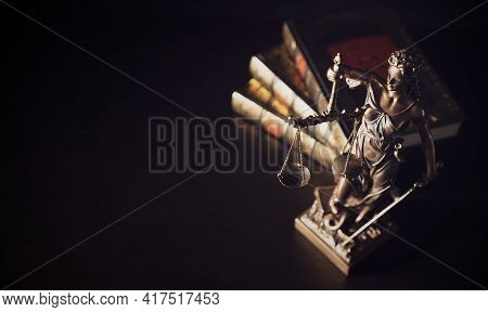 Lady Justice. Statue Of Justice In Library. Legal And Law Background Concept