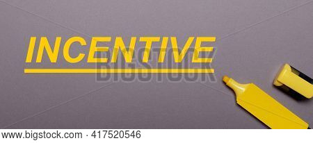 On A Gray Background, Yellow Marker And Yellow Inscription Incentive