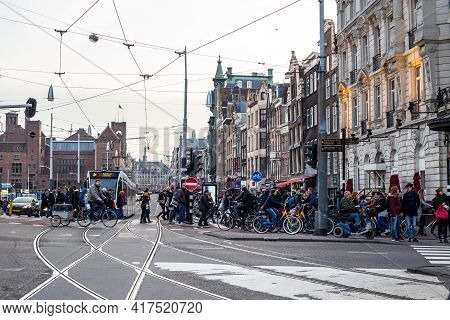 Amsterdam, Netherlands - March 11, 2017: View Of Busy Streets Of Amsterdam City Center