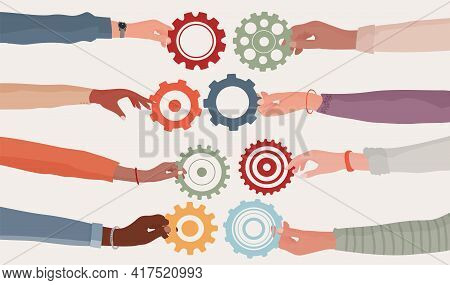 Cooperation Teamwork And Collaboration Concept. Hands Holding A Gear That Connects To Another Cogwhe