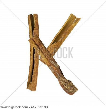 Cinnamon Font. Letter K Is Made From Pieces Of Cinnamon On White Isolated. Alphabet Letters Font Set