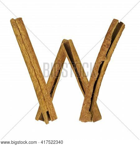 Cinnamon Font. Letter W Is Made From Pieces Of Cinnamon On White Isolated. Alphabet Letters Font Set
